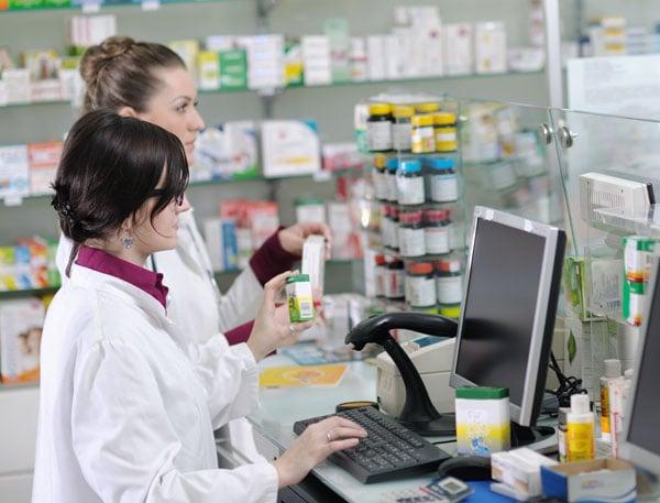 Clerk and pharmacist in pharmacy workflow
